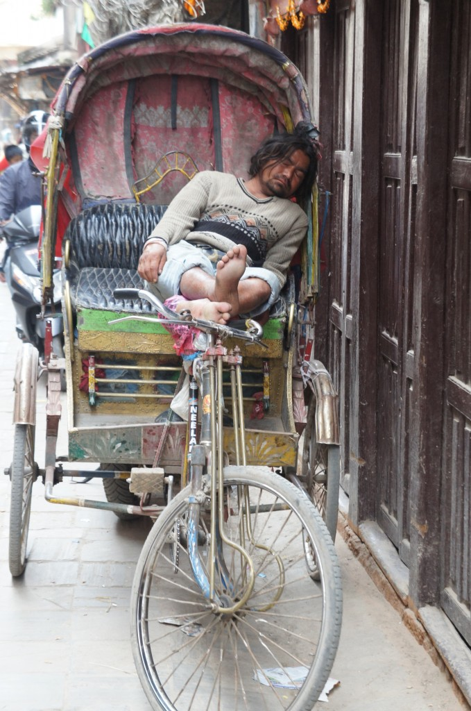 Taking a siesta. Rickshaw driver