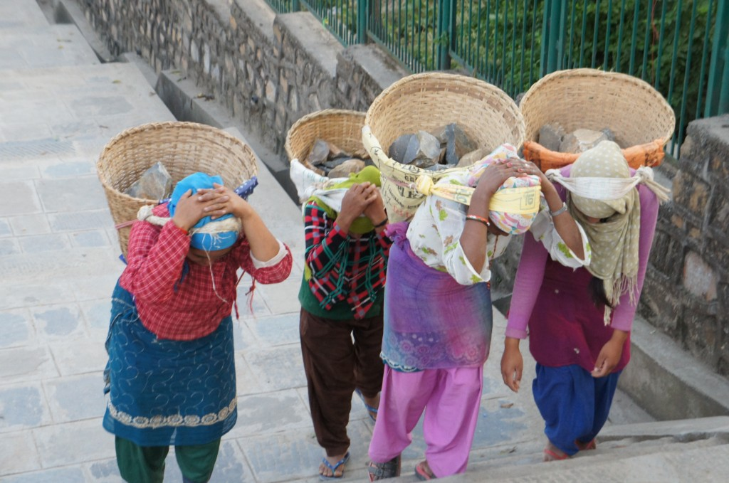 Traditional way of carrying heavy objects by women in Nepal