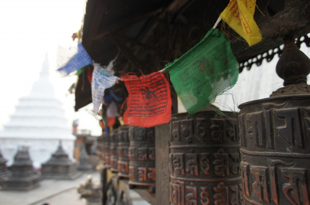 Swayambhunath temple, prayer flags and prayer wheels, with mantras on it to be spread with the wind