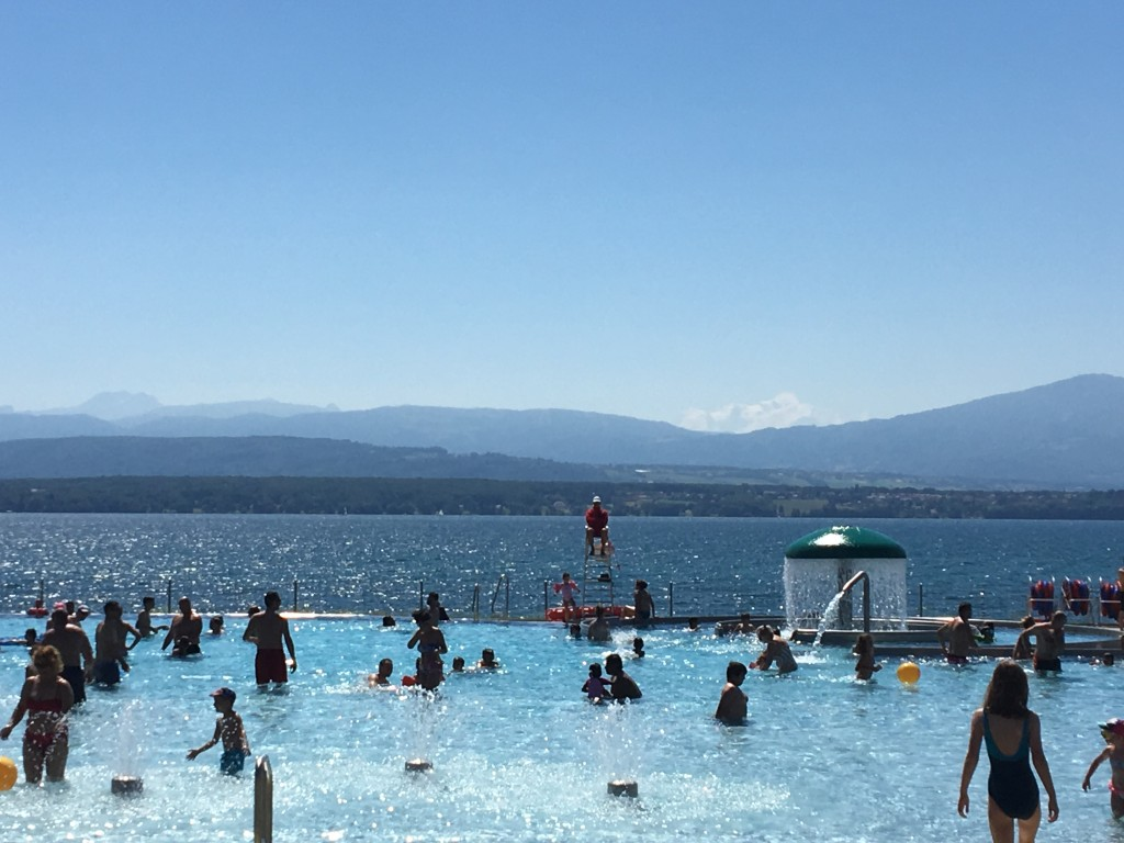 Swimming pool and beach looking at the Alps in the same spot